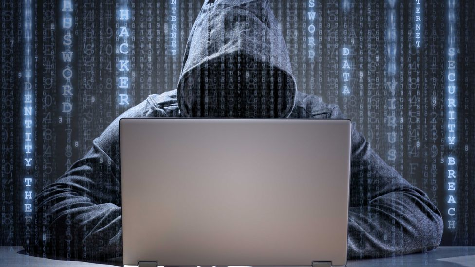 This is often how journalists and stock photos depict hackers, but it's not the truth (Credit: iStock)