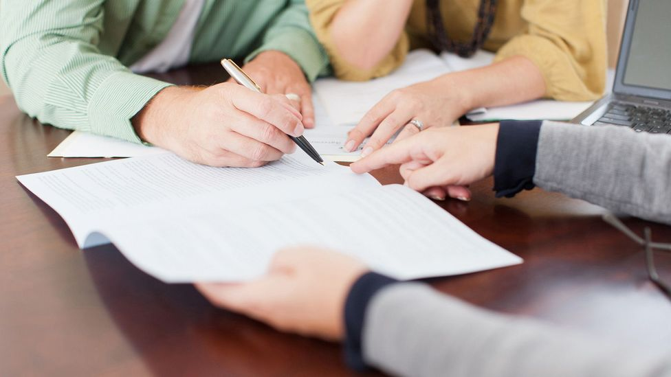 Borrowers are less likely to make their payments on time if the loan manager is a woman (Credit: Getty Images)
