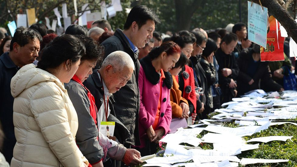 Parents gather at a matchmaking corner in Xi'an to scout for potential partners for their children (Credit Alamy)