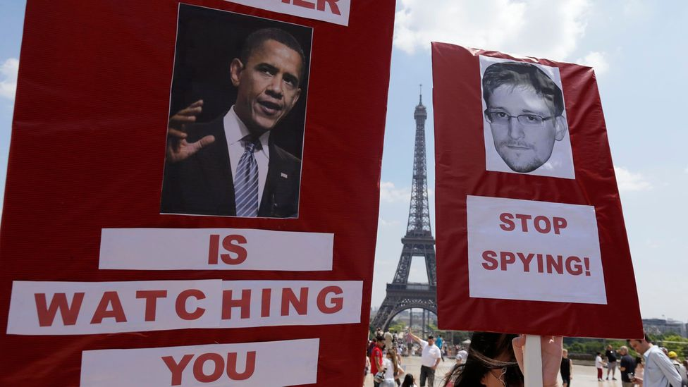 Protests around the world in recent years have called for safeguarding personal freedom on the internet from governments fighting terrorism (Credit: Getty Images)