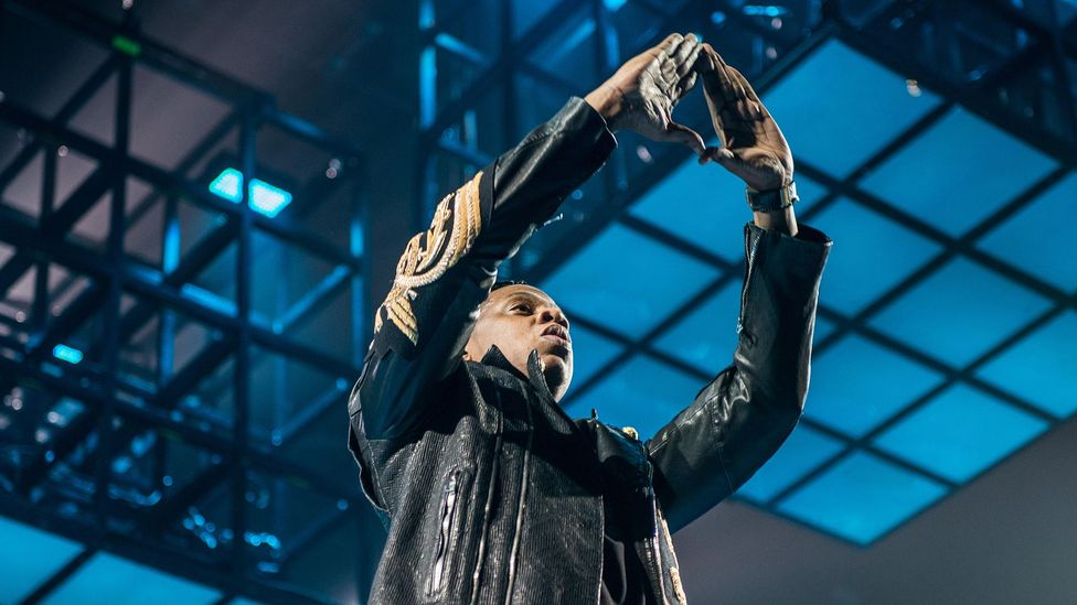 Jay Z is one famous hip hop star to raise their hands into the alleged Illuminati triangle symbol at concerts (Credit: Alamy)