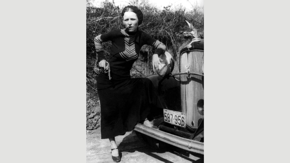 Bonnie Parker embraced the image of the 'gun moll' and scandalised newspaper readers by smoking cigars (Credit: Alamy)