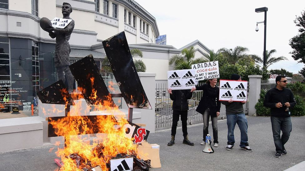 A group of activists protest the price Adidas were charging New Zealanders for the All Black rugby jersey in 2011 (Credit: Getty Images)