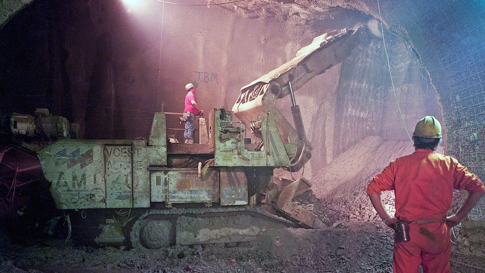Workers excavate rock in the Channel Tunnel in 1989, 8km from the UK coast (Credit: Alamy)
