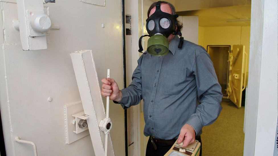 Man in gas mask (Credit: Alamy)