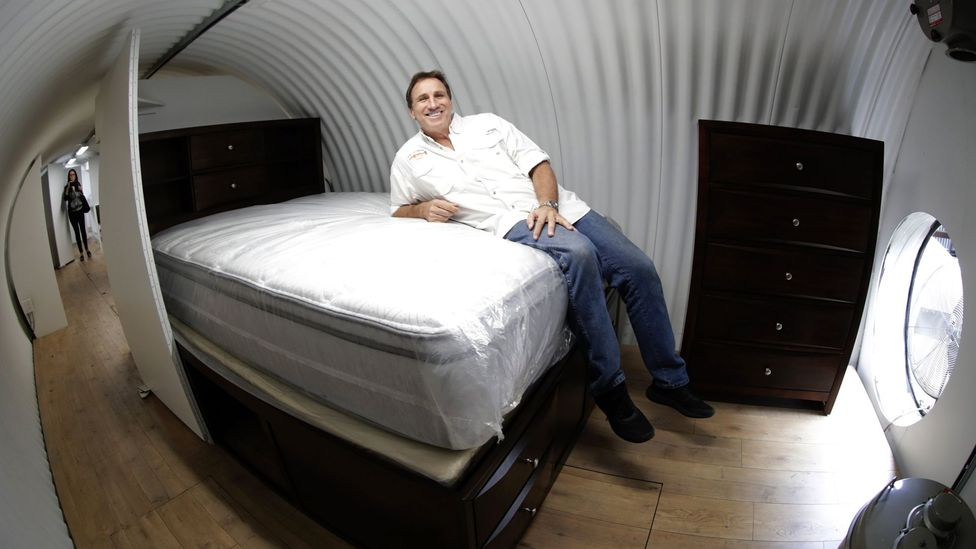 Shelter salesman on bed (Credit: EPA)