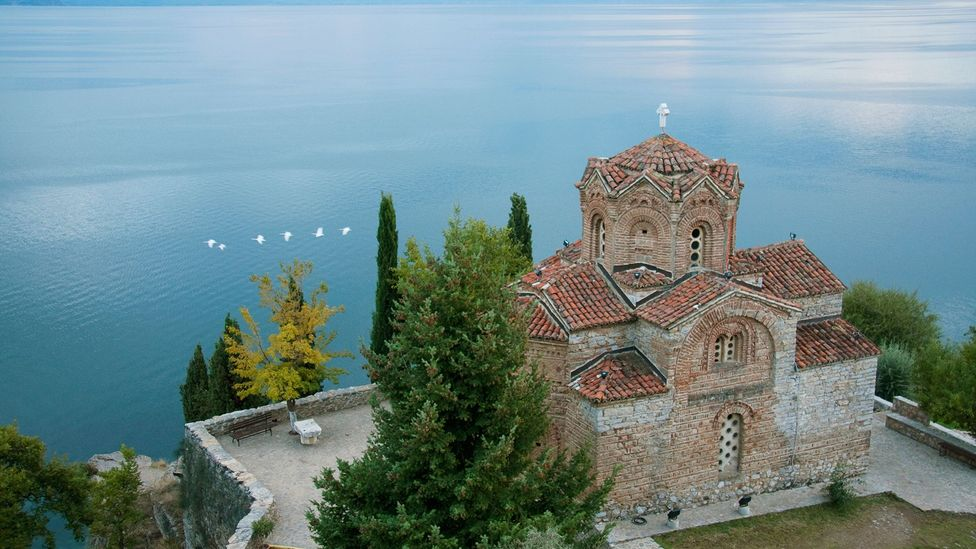 The Church of St Jovan and Lake Ohrid in Macedonia (Credit: Insights/Contributor/Getty Images)