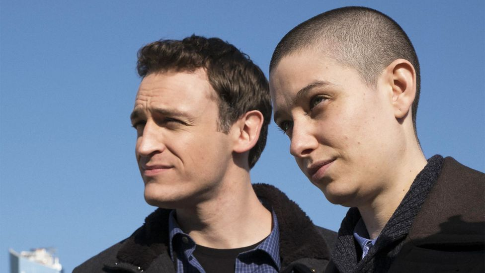 Non-binary actor Asia Kate Dillon (right) as Taylor Mason, the razor-sharp non-binary hedge fund intern on TV series Billions (Credit: Alamy)
