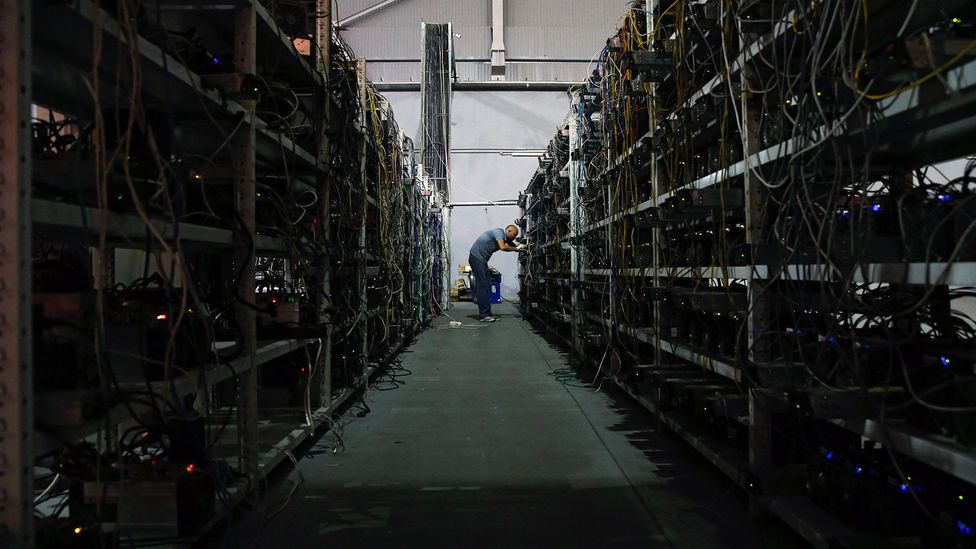 Mining Bitcoin takes time and computer processing power, so it's often done in massive farms such as this converted warehouse in Moscow, Russia (Credit: Getty Images)