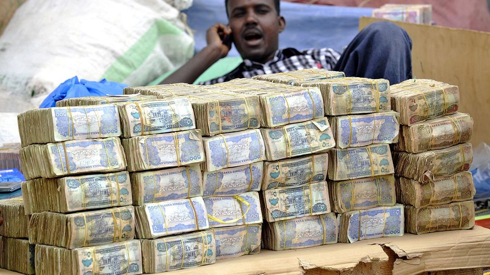 One US dollar equals 9,000 Somliland shillings - the currency is so devalued, shoppers wander markets with wads of the paper money thrown in their bags (Credit: AFP/Simon Maina)