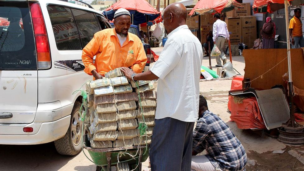 In Somaliland, stacks and stacks of the local devalued physical currency are rapidly falling out of fashion - people are turning to digital payments (Credit: Matthew Vickery)