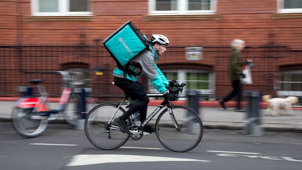 Companies like Deliveroo have been criticised for their pay and working conditions (Credit: Getty Images)