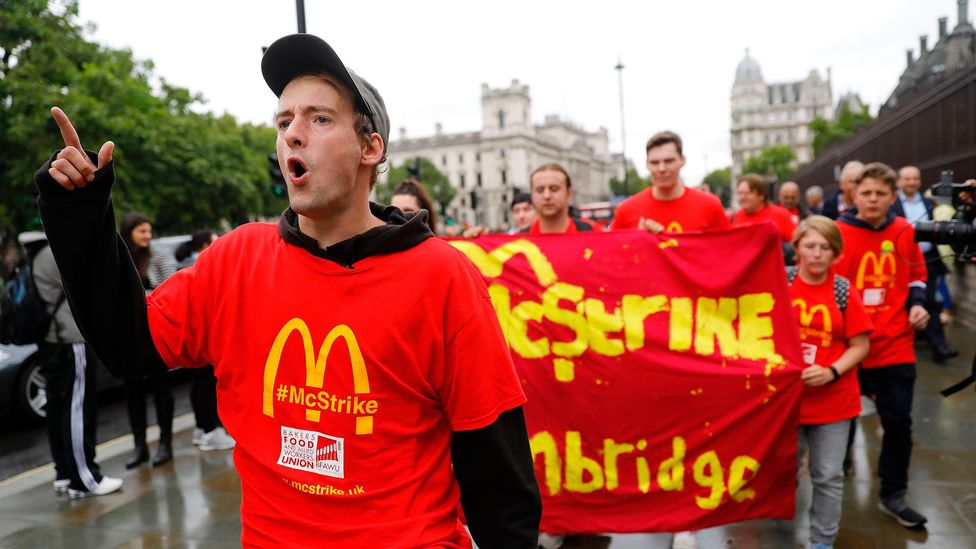 Demonstrators protest working conditions and zero-hour contracts in central London on 4 September (Credit: Getty Images)