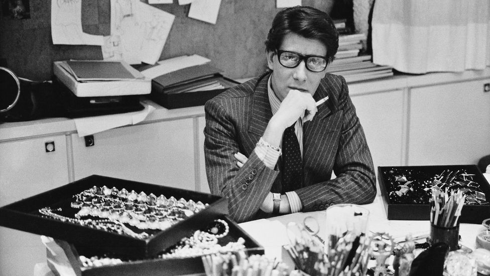 Saint Laurent, seen here in his studio in 1986, has retained his cult appeal decades later (Credit: Musée Yves Saint Laurent Paris/DR)
