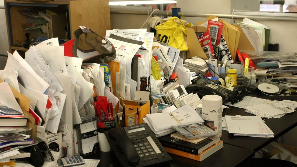 Can't see your desk under all the mess? Lavie's experiments suggest you're onto something (Credit: Alamy)
