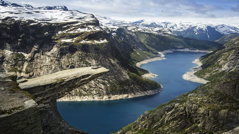 Trolltunga, which translates to 'Troll's Tongue', juts out 700m above Norway's Lake Ringedalsvatnet (Credit: Thomas Trutschel/Getty Images)