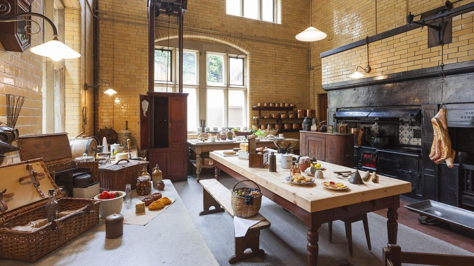 The kitchen at Cragside in Northumberland was the first to be powered by hydroelectricity – the adoption of chimneys had increased the gap between classes (Credit: Alamy)