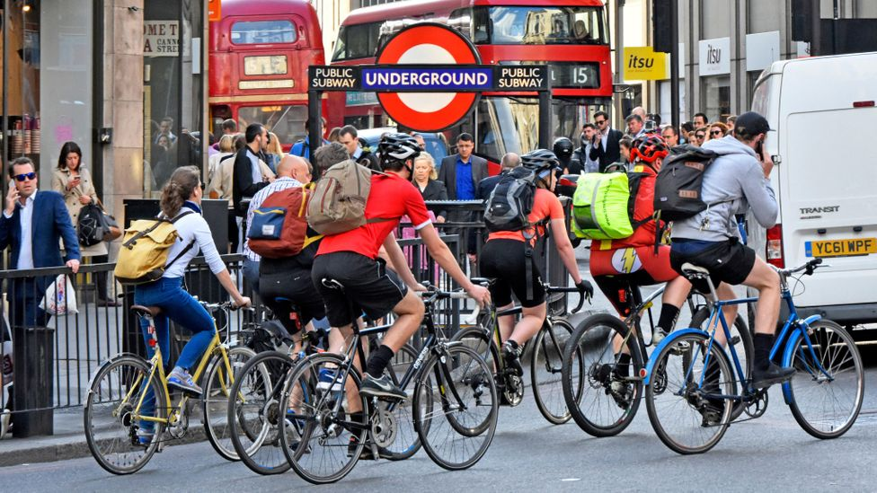 A group of empowered Gen Y cyclists who have cast aside the shackles of car ownership, killing the auto industry in the process (Credit: Alamy)