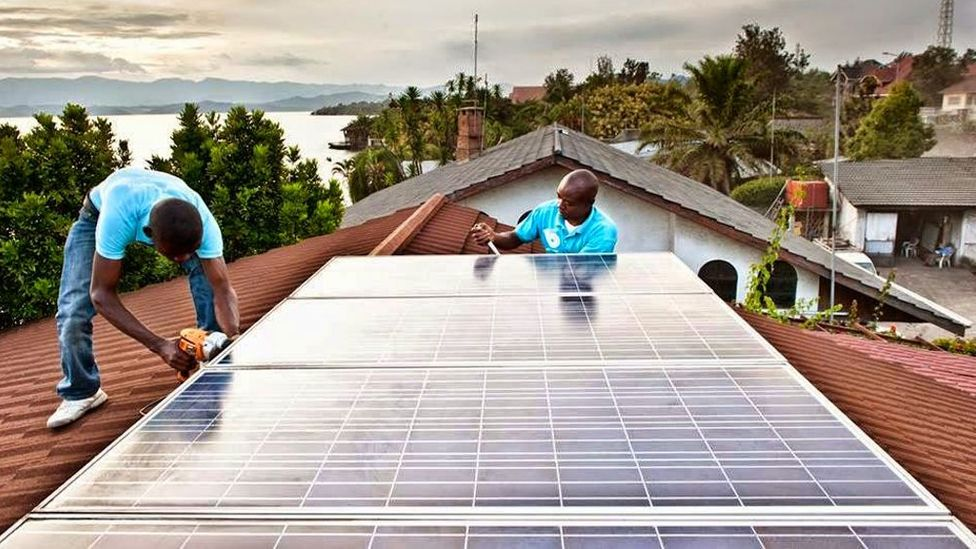 BBOXX technicians installing a large system in Goma, on the shores of Rwanda's Lake Kivu, where the electricity is unreliable (Credit: BBOXX)