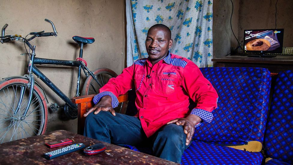 """Being off the grid """"was a big challenge as we couldn't bring light into our homes or charge our mobile phones,"""" says Bimenyimana Philippe (Credit: BBOXX)"""