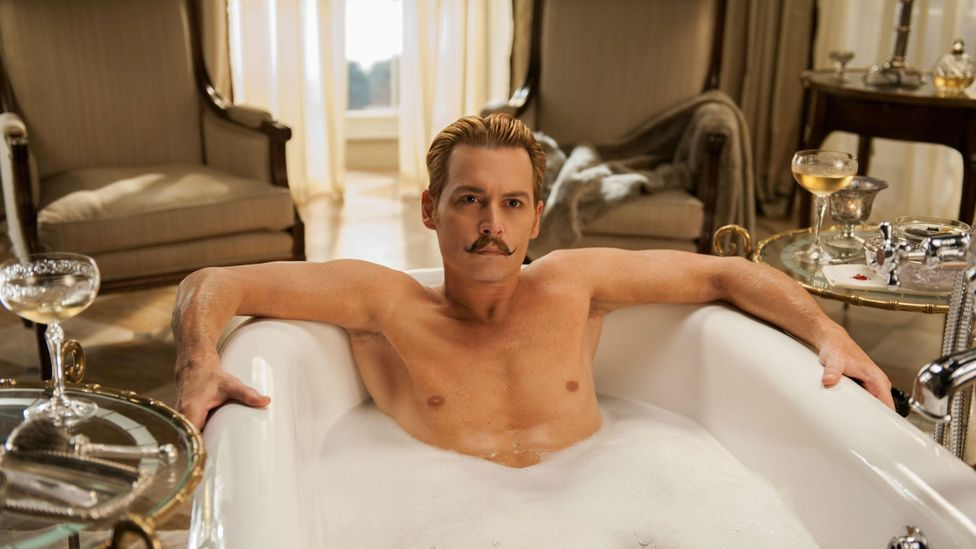 Johnny Depp starred as Charlie Mortdecai in the film Mortdecai, based on the character created by Kyril Bonfiglioli (Credit: Alamy)