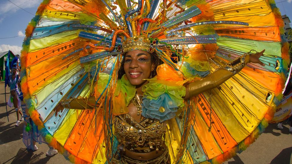 Carnival in Trinidad still follows the global calendar of Carnival events that take place before Lent, while Notting Hill Carnival takes place in late summer (Credit: Alamy)