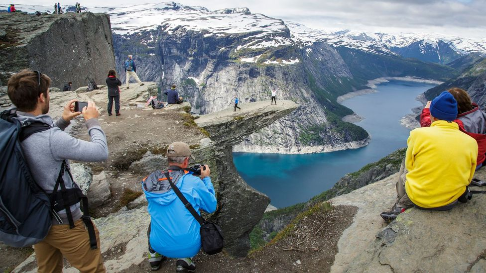 Norway visitors often take advantage of allemansratten, an ancient 'right to roam' (Credit: Thomas Trutschel/Getty Images)