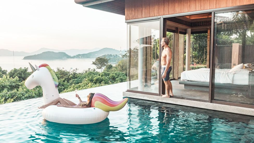 Collette and Scott Stohler watching the sunset over the Andaman Sea in Phuket, Thailand (Credit: Scott Stohler)