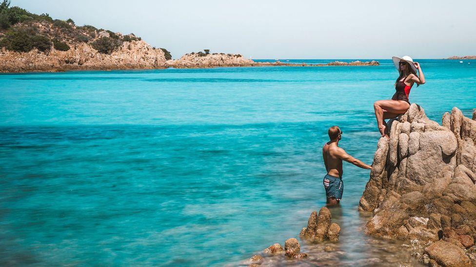 The couple enjoying the turquoise Sardinian waters at Spiaggia Del Principe in Porto Cervo, Sardinia (Credit: Scott Stohler)