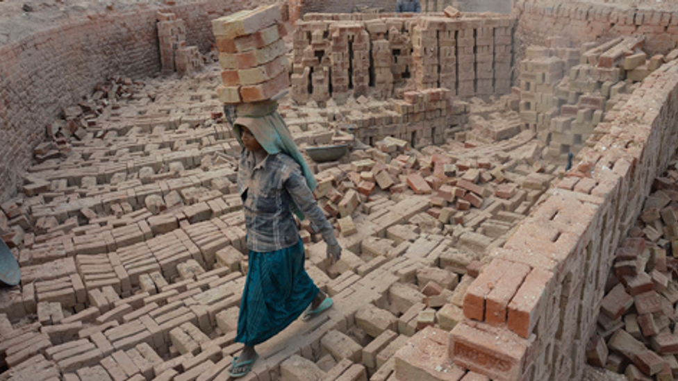 An Indian woman works at a brick kiln on the International Women's Day in Dimapur, India north eastern state of Nagaland (Credit: Getty Images)