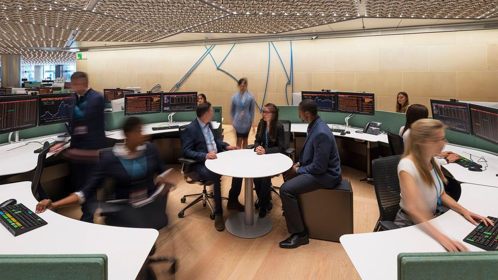 Each employee sits in their own space within a circular formation of desks, with a table in the middle to encourage impromptu meetings (Credit: James Newton)