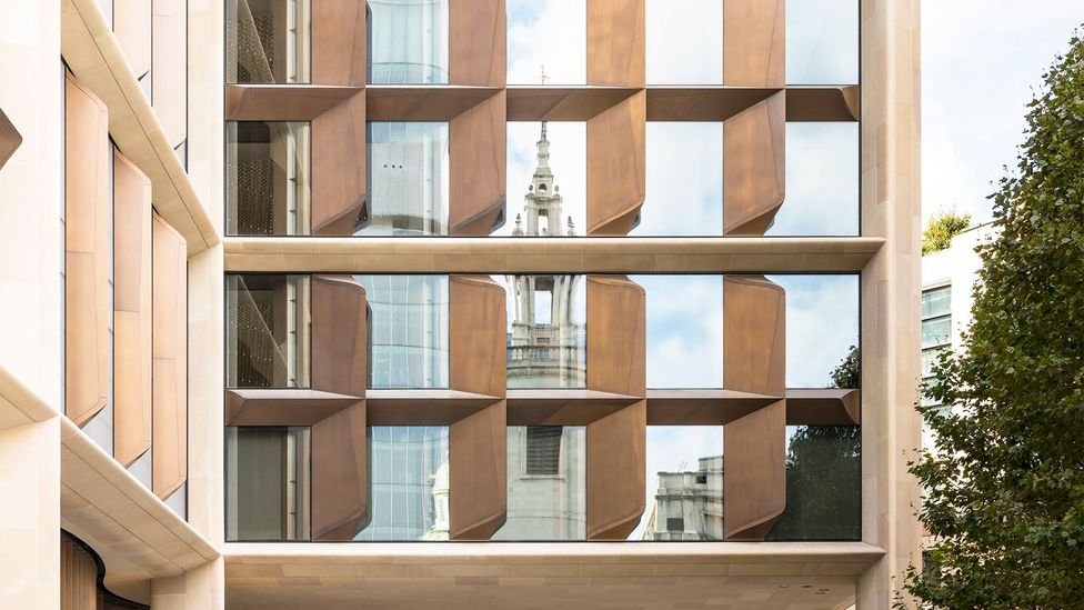 Christopher Wren's St Stephen Walbrook is reflected by the façade, a deep stone frame with serrated glass and bronze 'gills' that ventilate (Credit: Nigel Young/Foster + Partners)