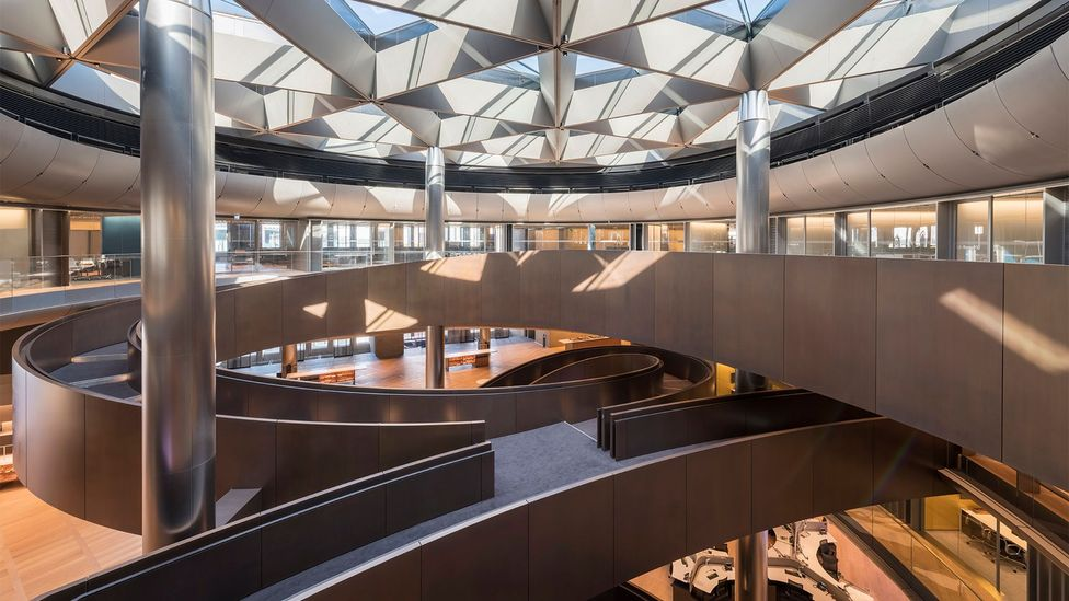 The centrepiece is a spiralling ramp spanning six floors in a triple-helix formation, designed as a place of meeting (Credit: Nigel Young/Foster + Partners)