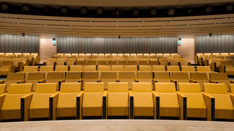 An auditorium is fitted with 'voice lift' technology that carries sound, so speakers and participants can talk and be heard without the need for microphones (Credit: James Newton)