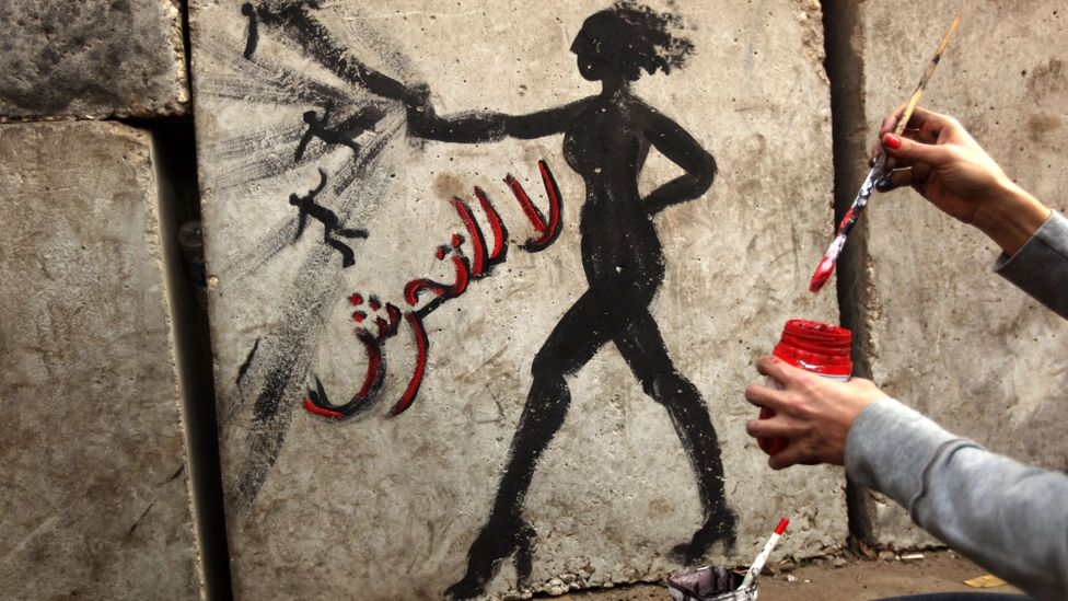 Graffiti reading 'no to sexual harassment' in Arabic on a wall outside the presidential palace in Cairo (Credit: Getty Images)