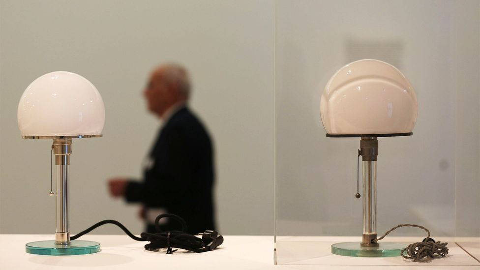 An original desk lamp by Wilhelm Wagenfeld, an iconic Bauhaus design, sits next to a modern replica in Germany's Bundeskunsthalle museum last year (Credit: Oliver Berg/DPA/Alamy)