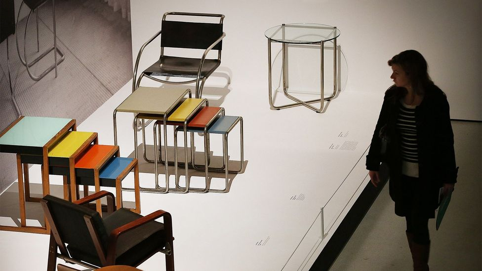 A visitor looks at tables and chairs on display at the 'Bauhaus Art as Life' exhibition in London, 2012 (Credit: Fred Duval/WireImage)