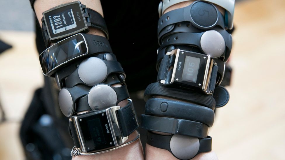 Under corporate wellness schemes, sensor-filled wristbands like FitBits and the Jawbone tracker are offered at subsidised prices, or even given out free. (Credit: Alamy)