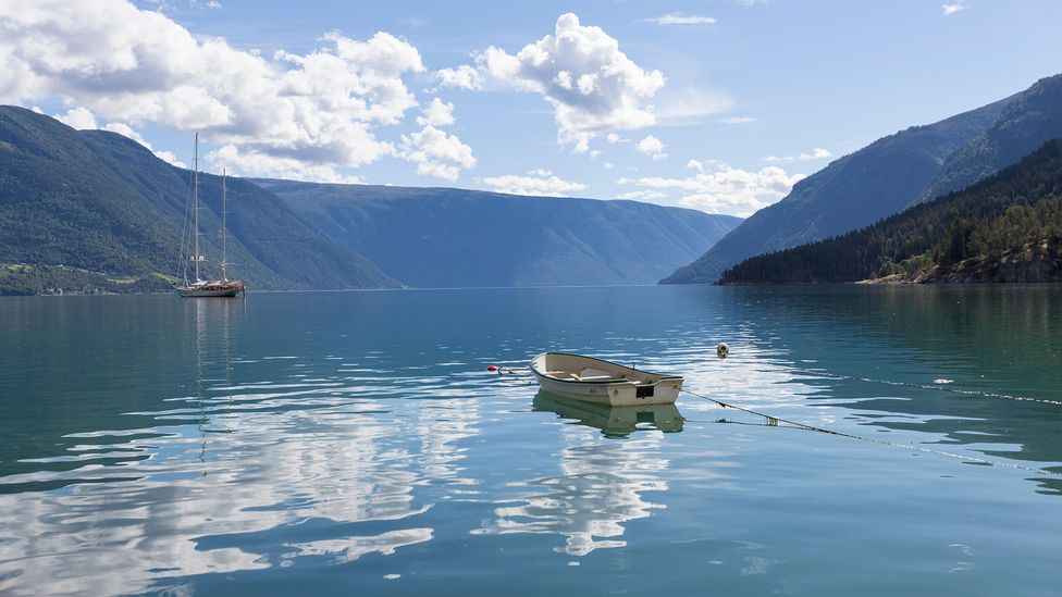The calm waters of a Norwegian fjord are very different to the rough seas of the open Atlantic (Credit: Alamy)