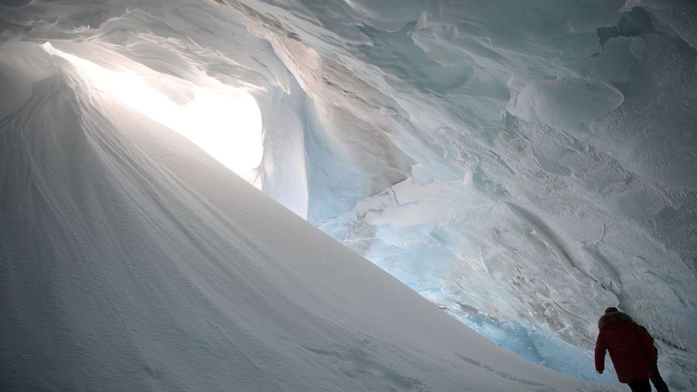 Russian President Vladimir Putin visits an ice cavern in the Arctic in March (Credit: Getty Images)