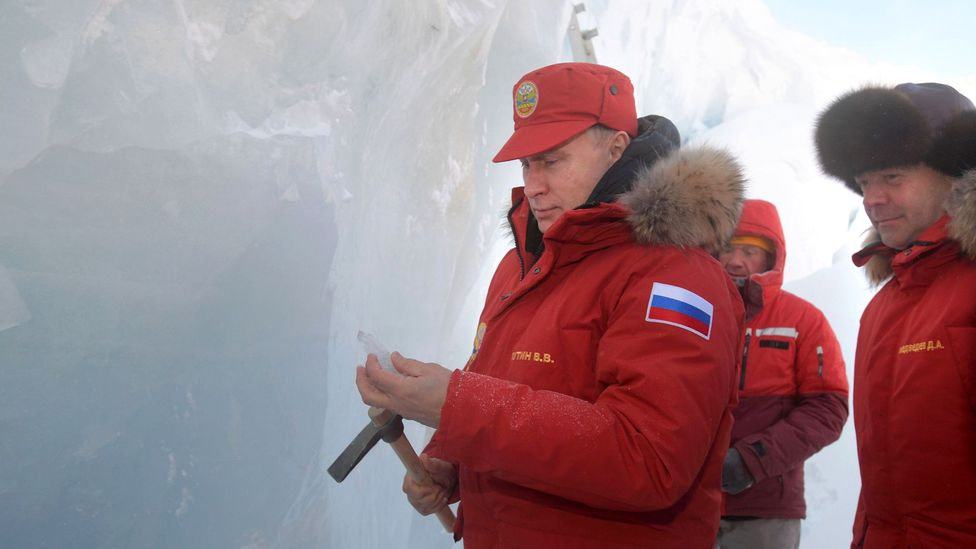 Russian President Vladimir Putin next to Prime Minister Dmitry Medvedev as they visit the remote Arctic islands of Franz Josef Land on March 29, 2017 (Credit: Getty Images)