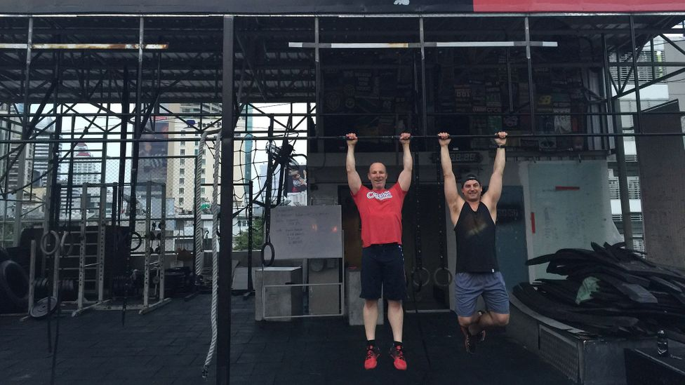 Bruce Eckfeldt (right) and Matt Schwartz, CEO of executive search firm MJS, working out at a crossfit box in Bangkok, Thailand (Credit: Bruce Eckfeldt)