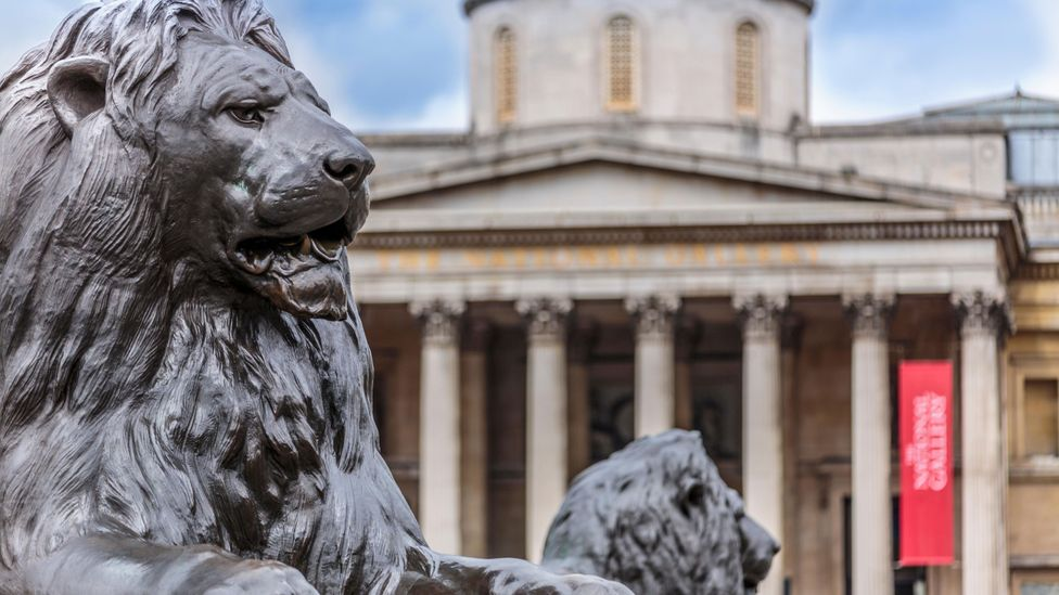 The four huge lions in London's Trafalgar Square were designed by Edwin Landseer and installed in 1867 (Credit: Alamy)