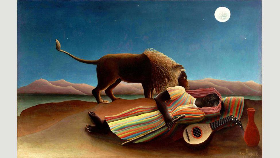 In Henri Rousseau's Sleeping Gypsy (1897), a moonlit lion sniffs a figure sleeping beside a mandolin (Credit: Alamy)