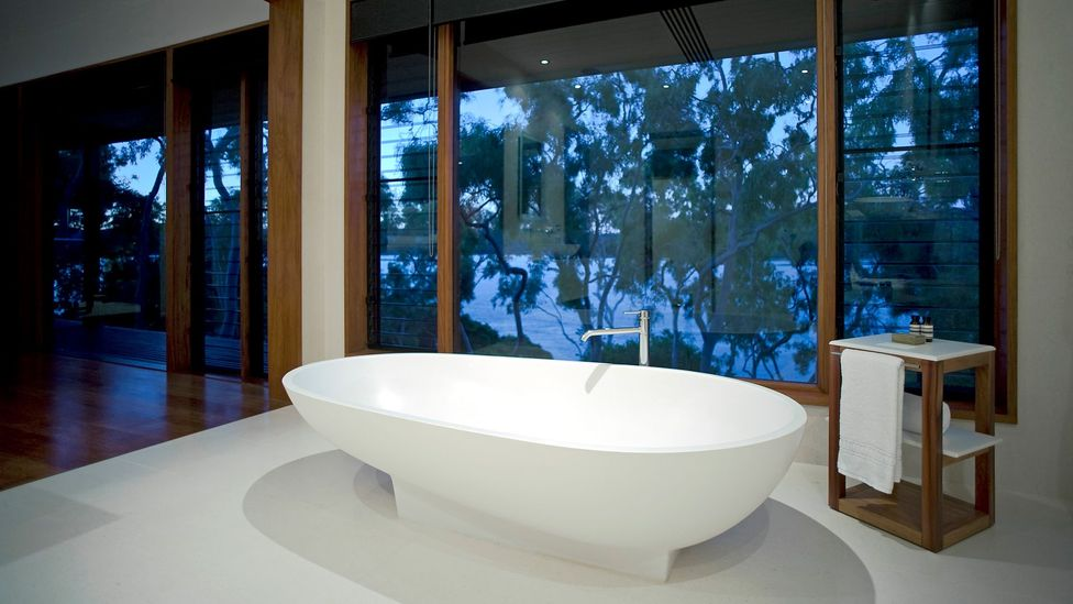 Contemporary bathrooms have come to resemble those of hotels, evolving into a sensual home spa, and an opportunity to showcase understated luxury (Credit: Getty Images)