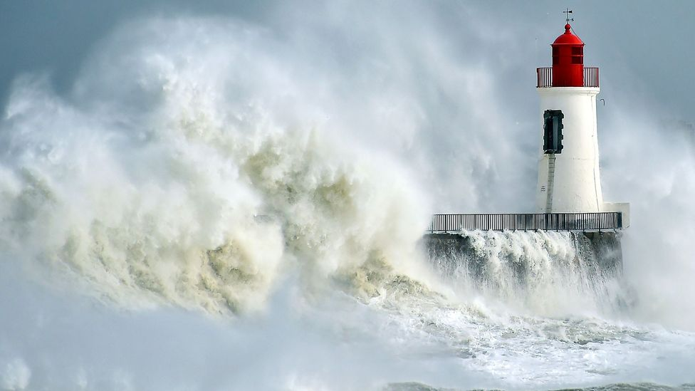 Waves pounding lighthouse (Credit: Getty Images)