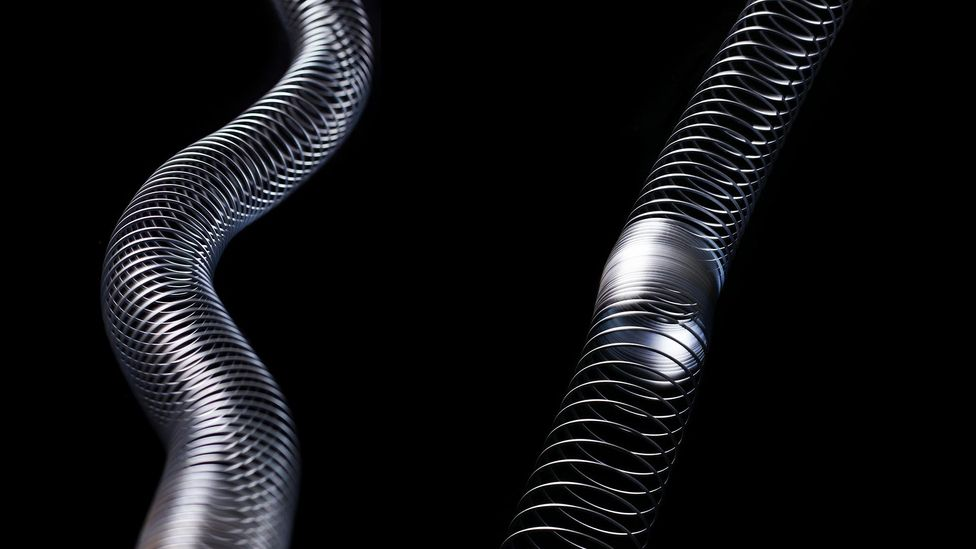 A slinky can be used to demonstrate two different types of seismic wave – the S wave on the left and the P wave on the right (Credit: Science Photo Library/Alamy)