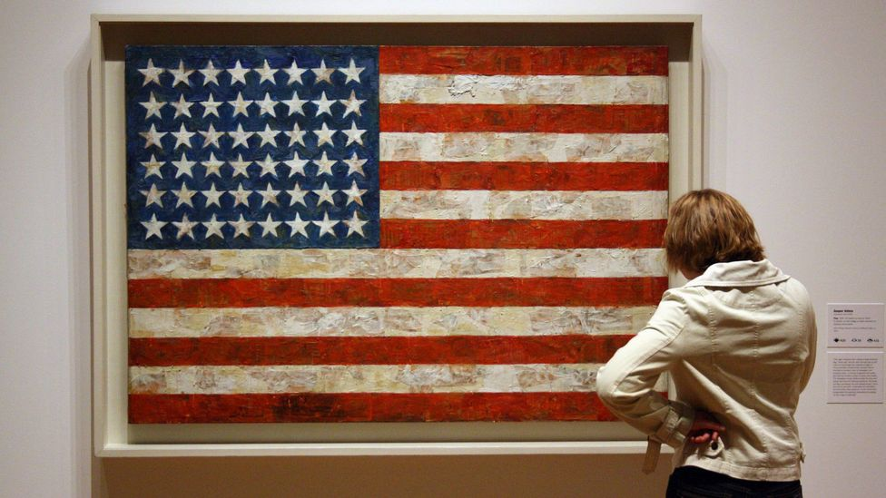 Jasper Johns' Flag posits questions similar to Magritte's work – is this a flag even though it's made up of painted bits of newspaper rather than cloth? (Credit: Alamy)