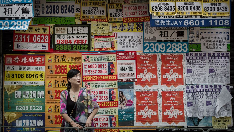 Soaring property prices in Hong Kong mean many younger people are considering investing in housing elsewhere (Credit: Getty Images)