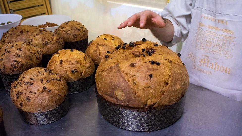 Fresh-baked panettone at a bakery in Milan (Credit: Amanda Ruggeri)